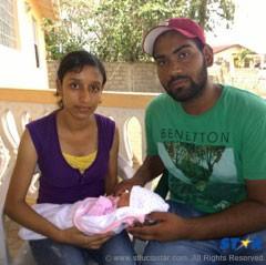 Gurjit Kaur, 23 with her baby boy  and her boyfriend.