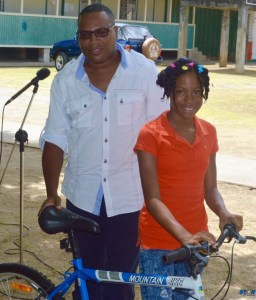 George Alcindor, MD Boka Estates Ltd, and top scorer for Canaries Primary, Jeannelle Smith.