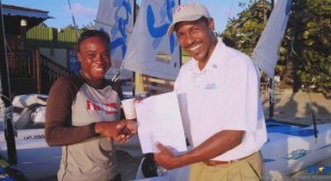 Aquatic Centre Manager at Sandals Grande Terrol Compton (r) congratulates Vanessa Eugene.