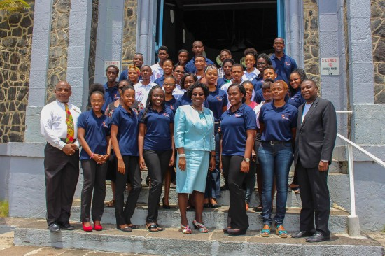 Members of the Laborie chapter of Volunteer Saint Lucia with Governor General Dame Pearlette Louisy and MP Alva Baptiste.