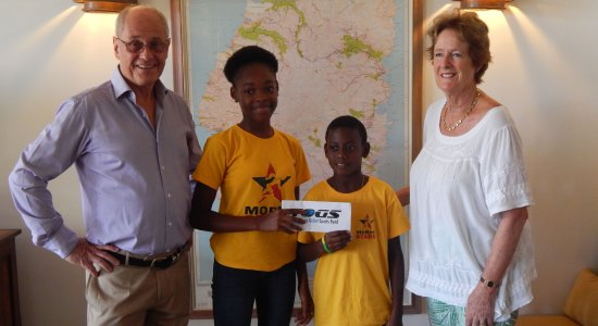 Young Morne Stars athletes, pictured with Theo and Helen Gobat, receive support from the Gobat Fund.