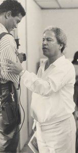 Former foreign affairs minister Neville Cenac (right) shares a word with Rick Wayne at a party convention in Micoud back in the early 80s.