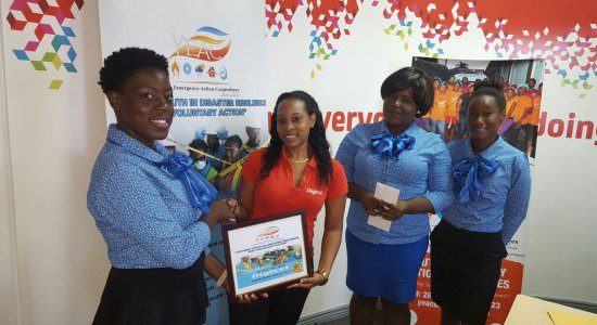 Members of the YEAC team thanking Digicel for its support.