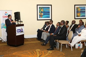 Hon Peter Turnquest delivering key note addess at the launch of CDM10