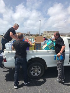 Colin MacDonald, Managing Director of C&W BVI, receives much-needed hurricane relief supplies, mobilised by Flow