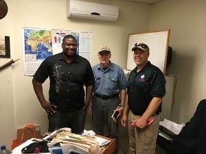 USAID DART Team lead John Kimbrough (center) and logistician Pat Long (right), in discussion with Sherrod James, Antigua and Barbuda's Deputy Director of the National Office of Disaster Services