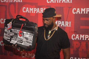 Soca Artiste and new Campari ambassador Bunji Garlin shows off his new Campari satchel