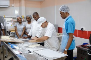 Baker Michael with Coconut Bay Resort's Chef David and students from the Sir Arthur Lewis Community College