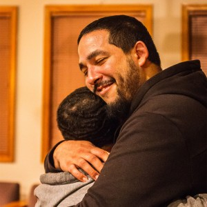 Hector hugs his child