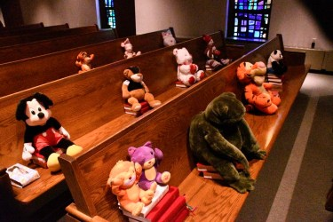 Pews with stuffed animals