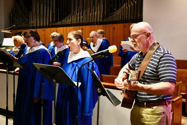 Choir and praise band musicians leading worship in the sanctuary