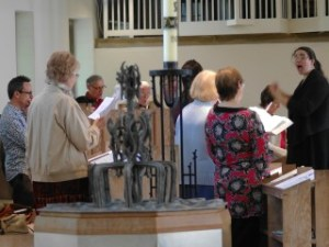 The Director of Music leads the choir during a service
