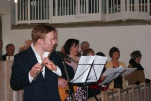 Musicians accompany the choir during a service