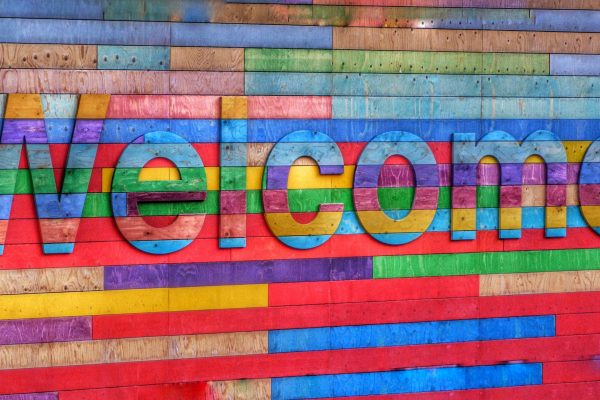 a colourful welcome sign