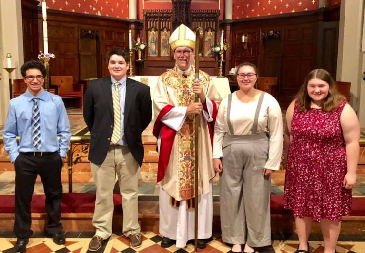 Young parishioners and the bishop at St. Michael's Episcopal Church.