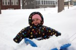 Maggie's sled gathers a lot of snow