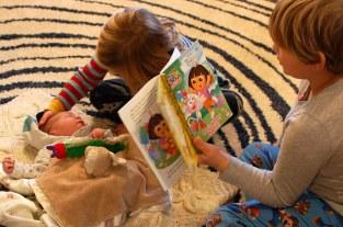 Griffin reading Dora