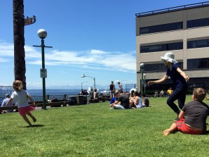 Carol indulged a game of tag with Maggie and Griffin on a beautiful sunny Seattle day.
