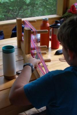 Griffin learning inkle weaving