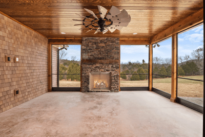 A Custom Built Sunroom With a Working Fireplace.