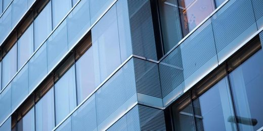 detail on office building made of glass and steel free stock image