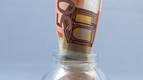 free stock image of saving money concept - euro banknote in jar