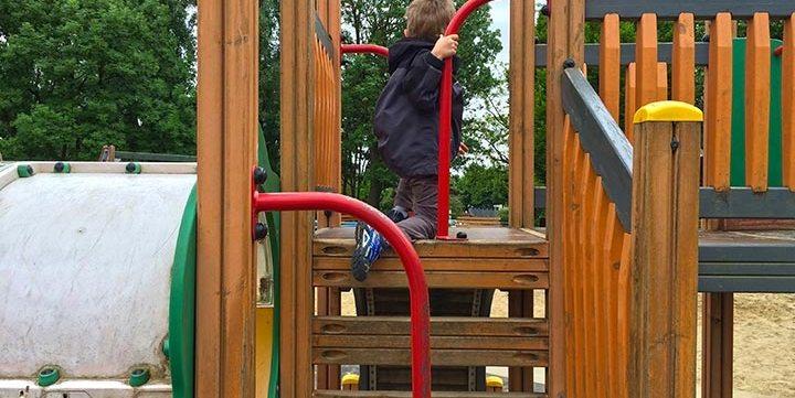 child in playground free stock image