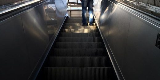 man on escalators free stock image