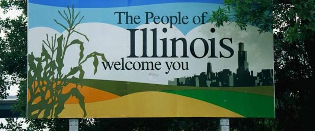 This is a road sign that says, the people of Illinois welcome you.