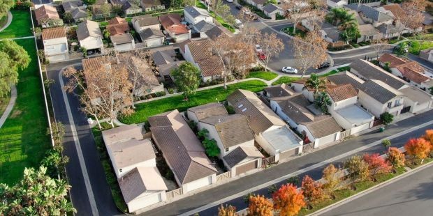 Pending home sales surge higher, but economists warn that the housing market could 'soon hit bottom'
