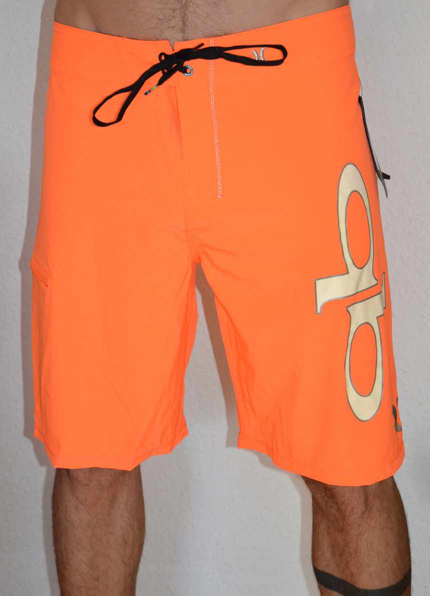 https://stokedforlife.org/wp-content/uploads/2016/11/Hurley-phantom-qb-board-short-orange-side.jpg