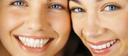 Women smiling --- Image by © Bernd Vogel/Veer/Corbis