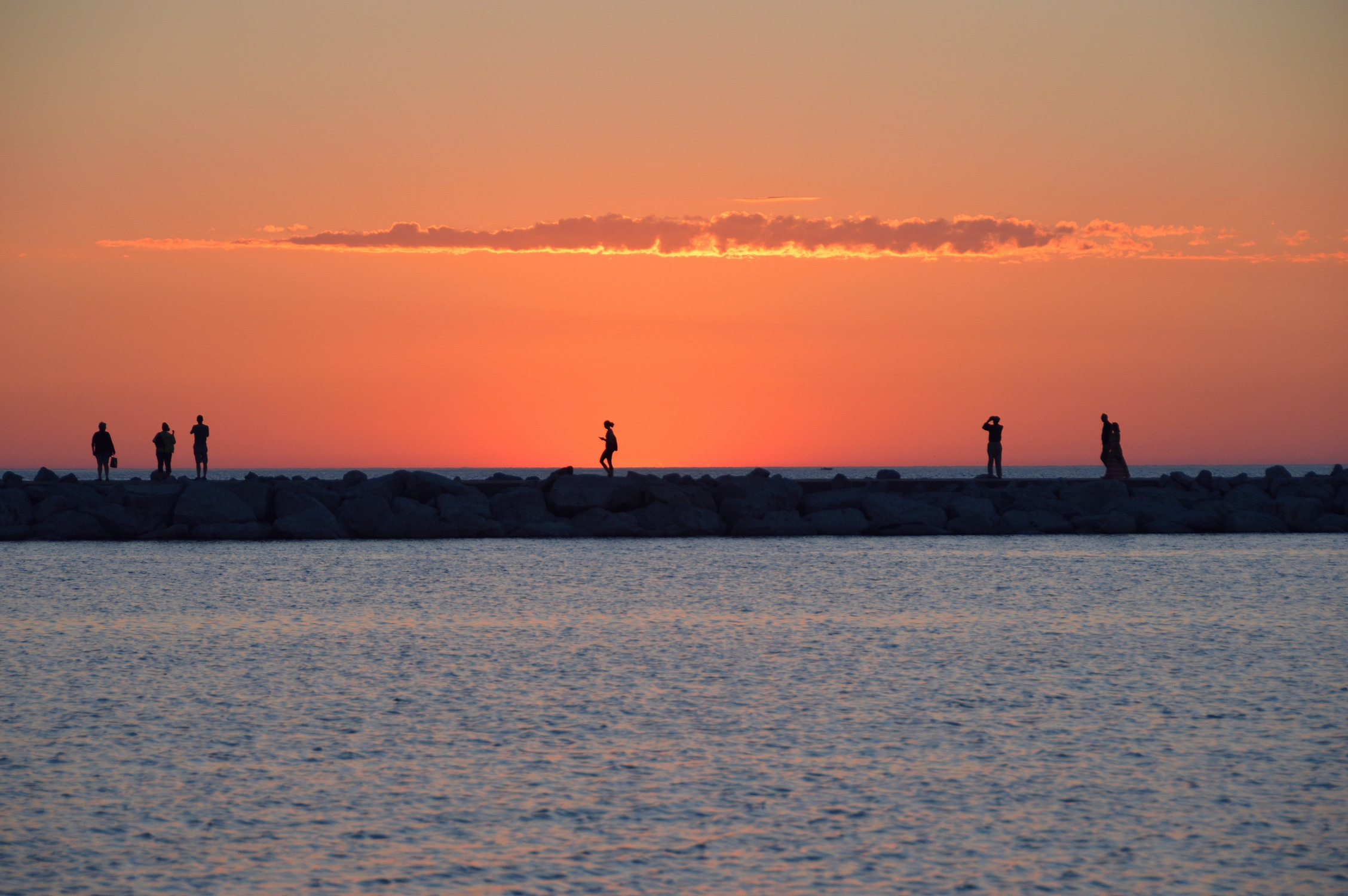 Sunset Behind The Breakwall In Petoskey Michigan