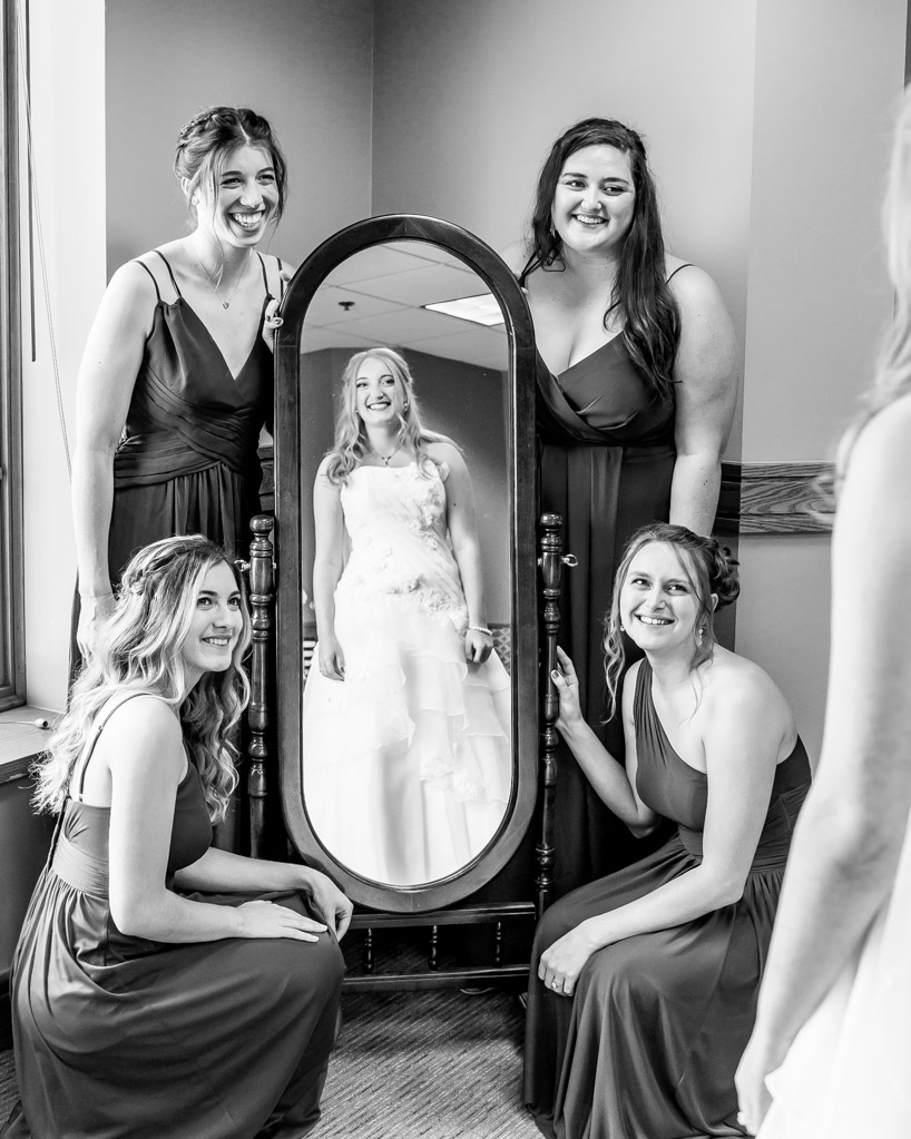 Bride Reflected In Mirror with Bridesmaids