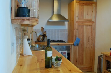 Hand made wooden kitchen in Harmony Barn cosy eco holiday cottage at Stones Cottages.
