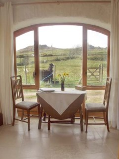 Self catering holiday cottage Sunset Barn dining table with views of Garn Fawr.