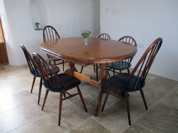 Large extendable pine dining table with 6 chairs.