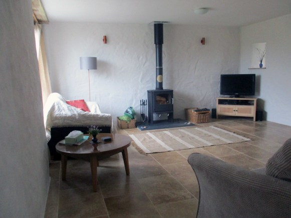 The spacious lounge with log burner.