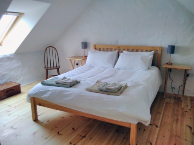 The Workshops double bed room with king sized bed, organic cotton sheets and views of the sea and St. David's Head from the large Velux window.