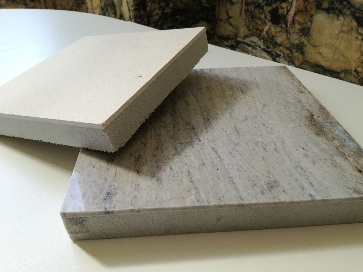 Foam Glass substrate faced with a thin laminate of natural or artificial stone.
