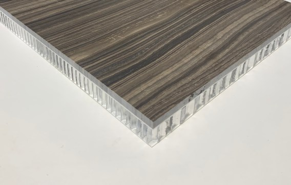 Aluminium honeycomb substrate faced with a thin laminate of natural or artificial stone.
