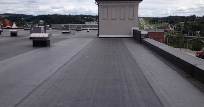 A single-ply roofing membrane on a commercial building.