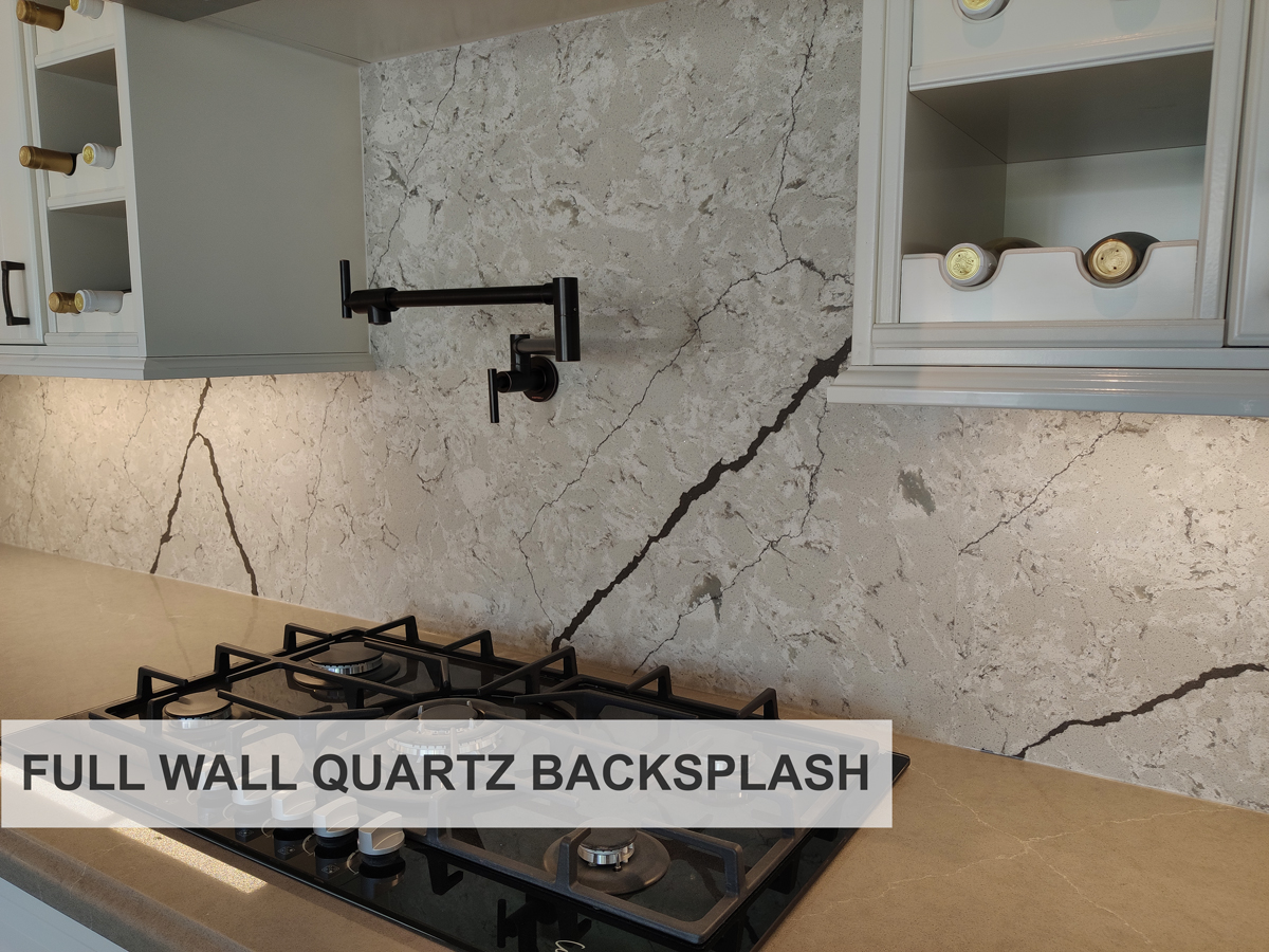 kitchen with cliff quartz countertop and full wall Mayfair quartz backsplash. both supplied and installed by Stone Wizards