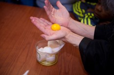 The iconographer teaches students who to separate a yolk for the paint using only his hands (Note: no Middle Schoolers were harmed in the separating of this egg yolk)