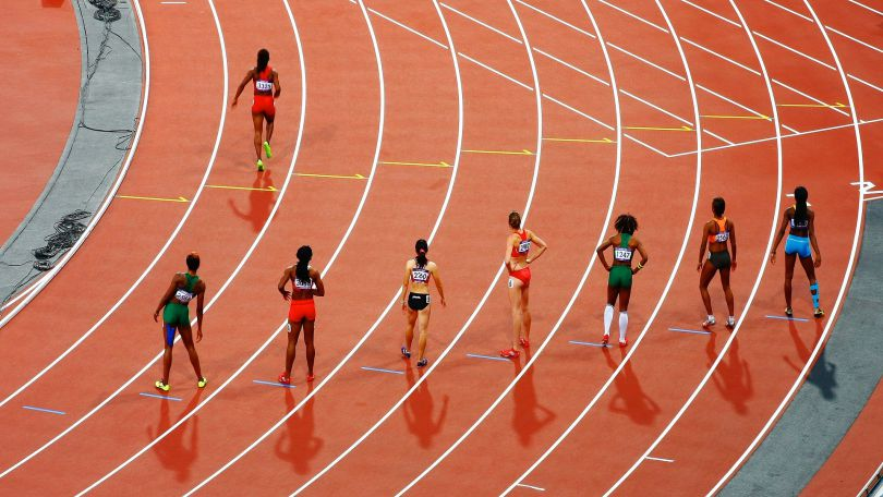 Individual Olympians running a race, indicating how each abuse survivor has its own race to run and is a champion