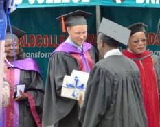 Ryan greeting a graduate.