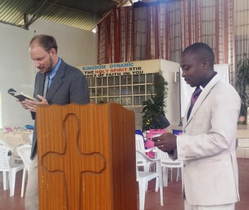 Preaching at Benew High School with Muchiri translating
