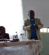 Canon Mwaura administered communion