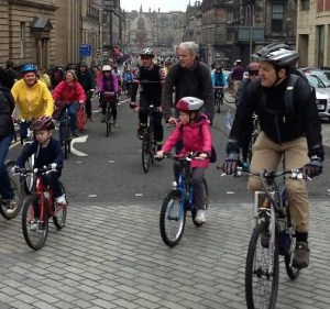 People of all ages cycling to Parliament (photo by Chris Hill on flickr)