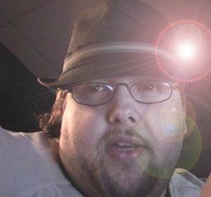 The best picture I could find of Myron.  Sorry ladies, his Fedora only tips for Paula Austin now.